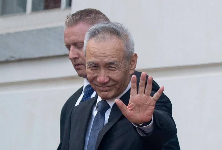 Commerce: les sanctions américaines entrent en vigueur, Pékin va répliquer