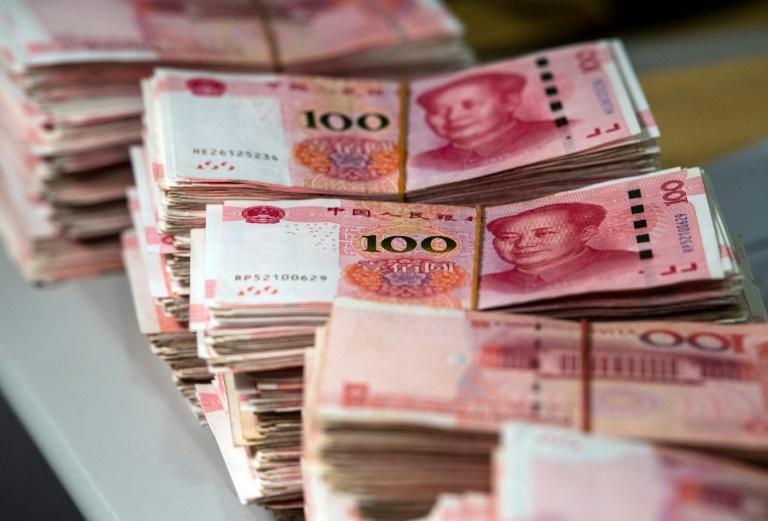 Commerce: la monnaie chinoise chute après les menaces de Trump