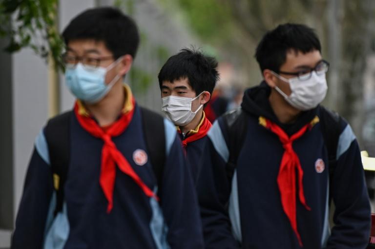 En Chine, rentrée ultra-sécurisée dans des lycées hantés par le virus