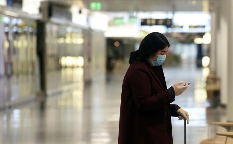 Coronavirus: des masques partout en Allemagne, un million de cas aux USA